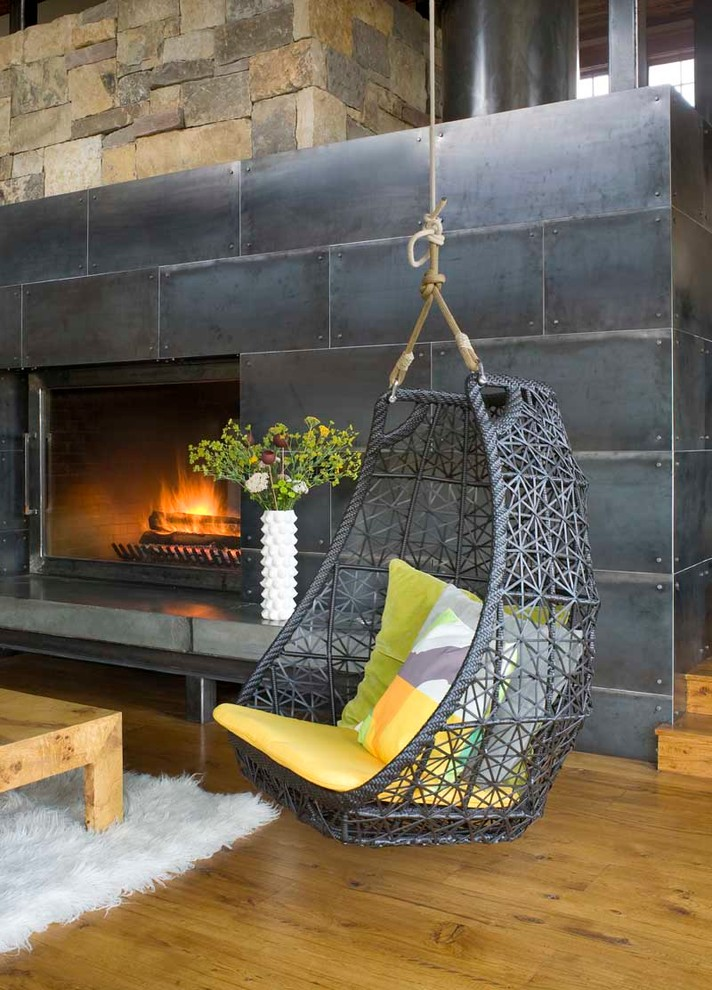 Living room - rustic living room idea in Denver with a metal fireplace
