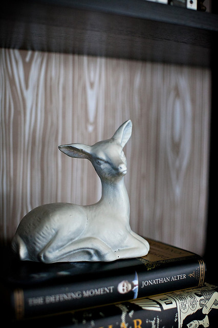 Faux Bois Backing a Bookcase with Vintage Deer Sculpture eclectic-living-room
