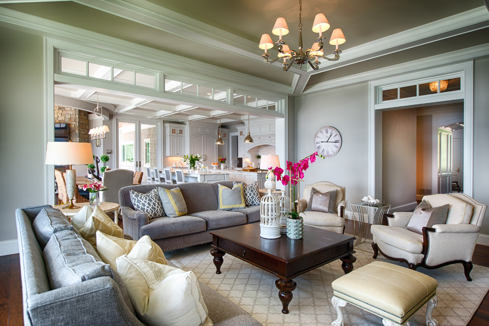 Example of a classic formal and open concept living room design in Minneapolis with gray walls