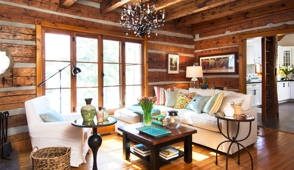 Mid-sized mountain style enclosed medium tone wood floor living room photo in Toronto with no tv