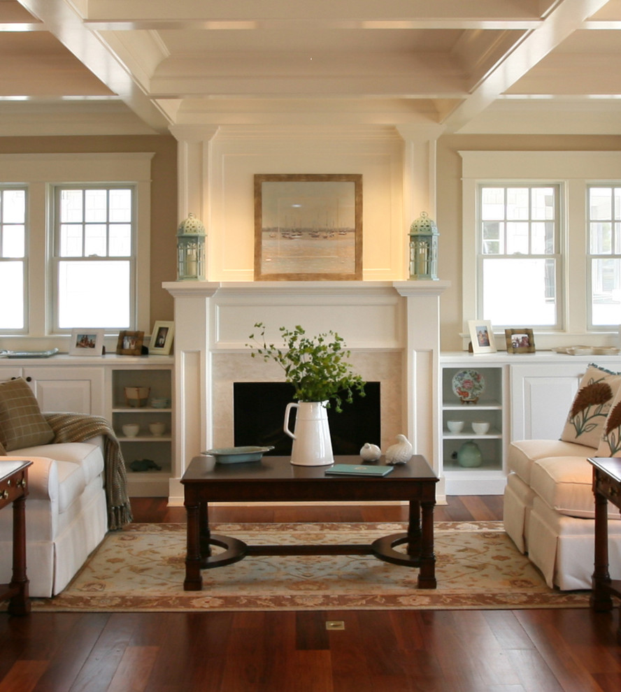 Inspiration for a coastal living room remodel in Philadelphia with beige walls and a standard fireplace