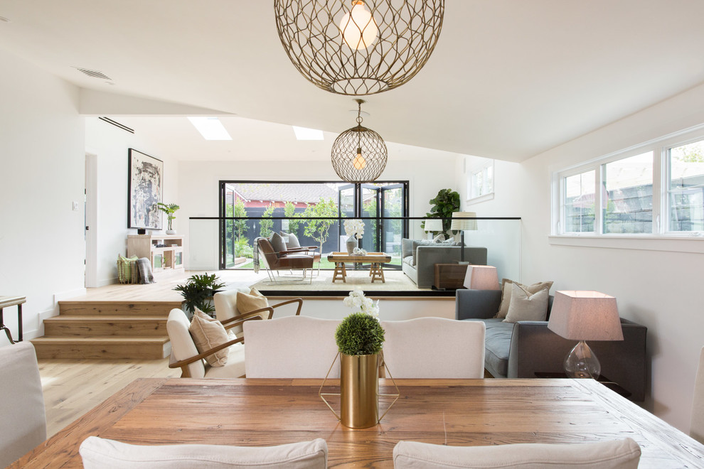 Living room - country open concept living room idea in Los Angeles with white walls