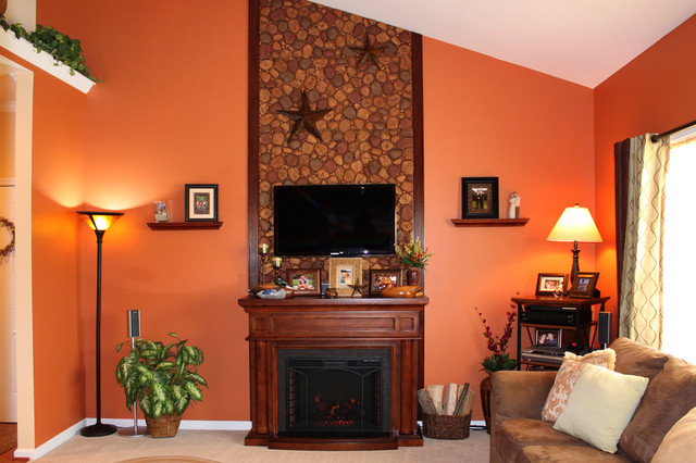 fireplace accent wall in faux river rock transitional living room