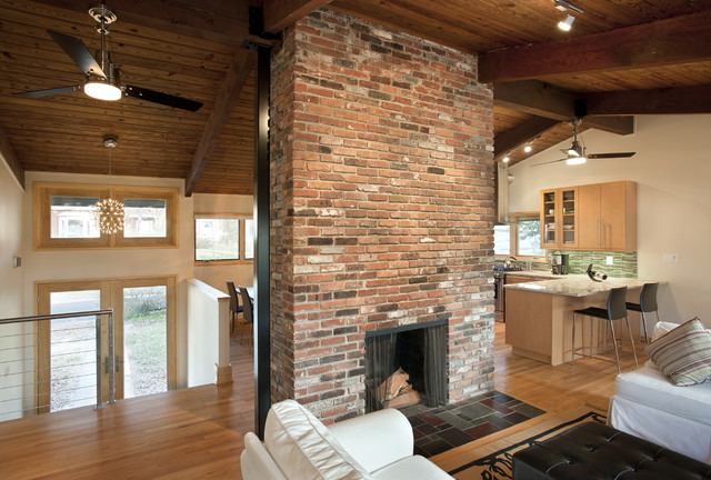 Fireplace at the center contemporary living room dc for Center chimney house plans