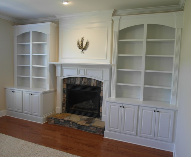 Fireplace built ins with divided arched bookcase Living room built ins with fireplace