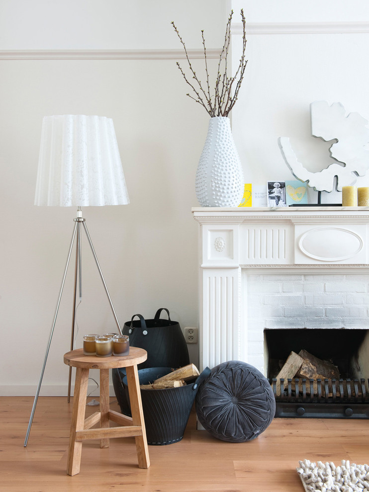 Eclectic living room photo in Amsterdam with a brick fireplace