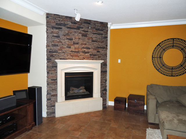 Drystack faux stone panels create an attractive accent wall for this living room fireplace.