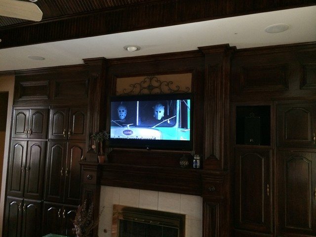 Fireplace tv installation southwestern living room for Tv solutions for living room
