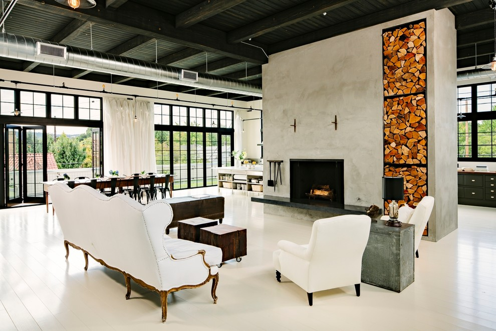 Inspiration for an industrial white floor living room remodel in Portland with a concrete fireplace