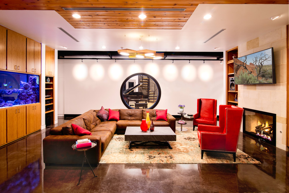 Trendy open concept concrete floor and brown floor living room photo in Austin with white walls, a standard fireplace, a wall-mounted tv and a stone fireplace