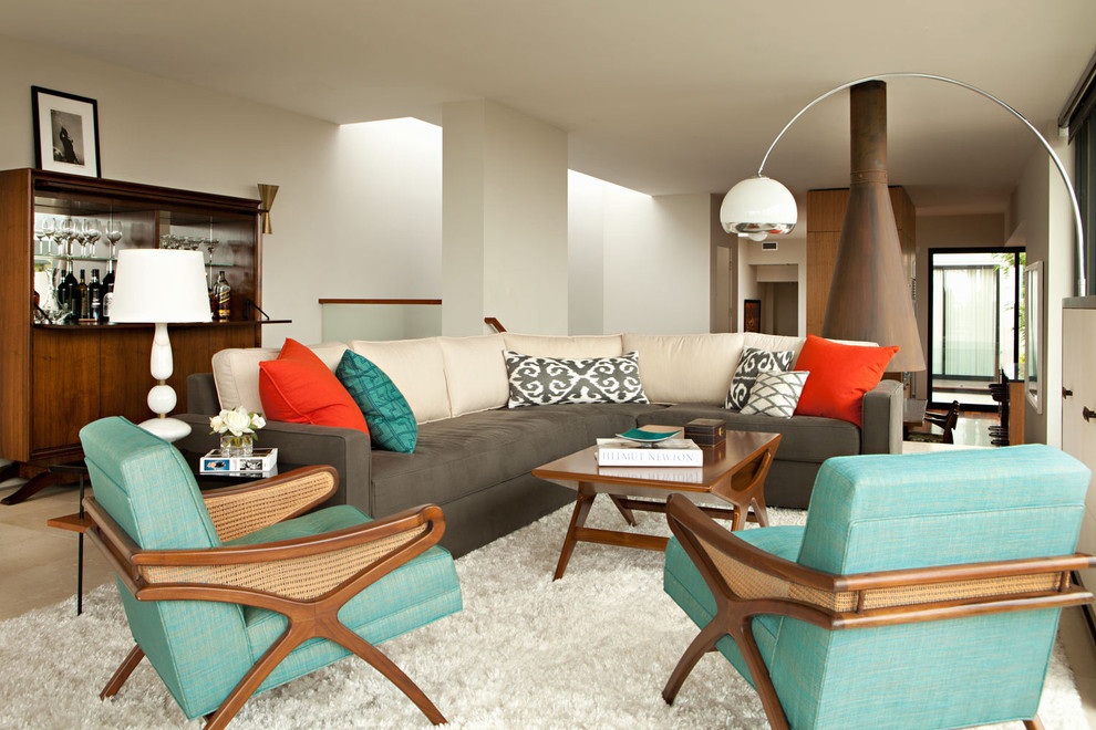 Example of a minimalist living room design in Los Angeles with white walls