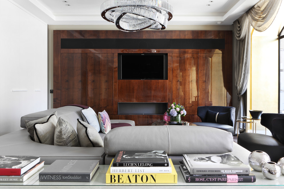 Living room - contemporary living room idea in London with a media wall