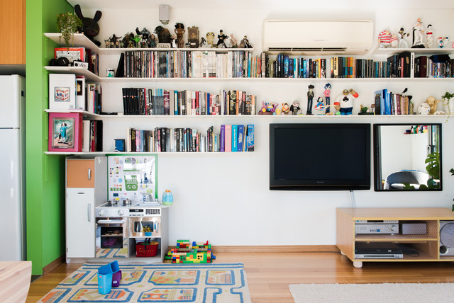Example of an eclectic living room design in Sydney with white walls