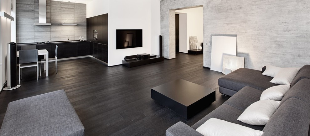 Large minimalist open concept dark wood floor and black floor living room photo in San Diego with gray walls and no fireplace