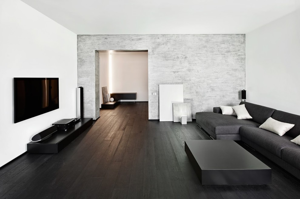 Inspiration for a mid-sized modern dark wood floor and black floor living room remodel in Miami with white walls and a wall-mounted tv