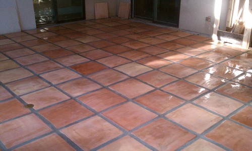 Can you re-grout over Saltillo tile?