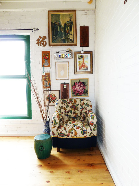 Floral Tufted Chair with Vintage Art eclectic living room