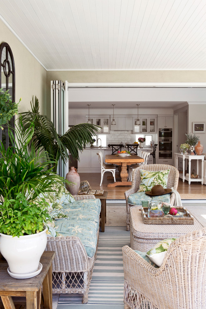 Example of a beach style living room design in Perth