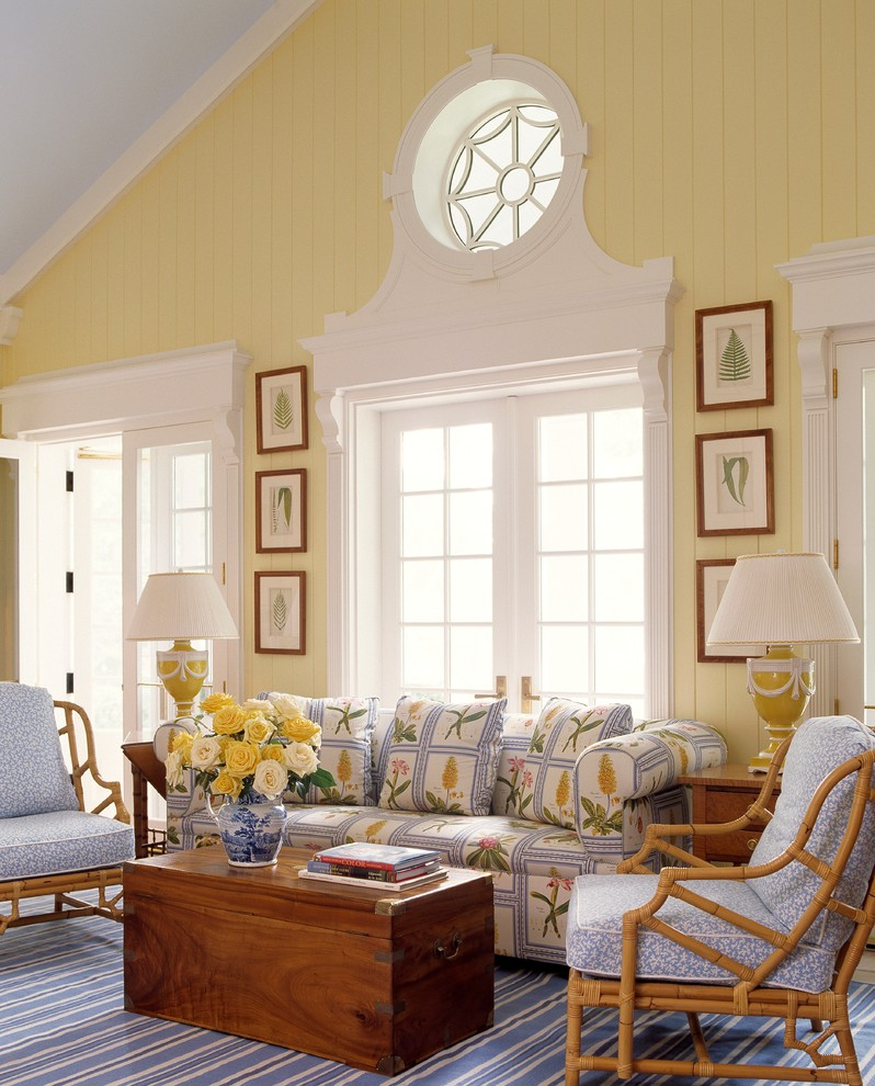Living room - tropical formal and open concept living room idea in Miami with yellow walls