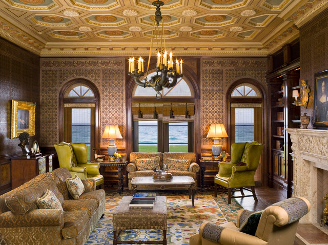 Example of a large tuscan formal and enclosed dark wood floor living room design in New York with multicolored walls, a standard fireplace and a plaster fireplace