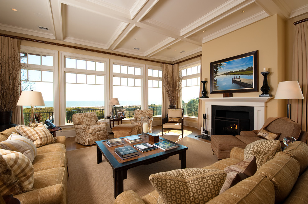 Example of a large classic living room design in Charleston with beige walls