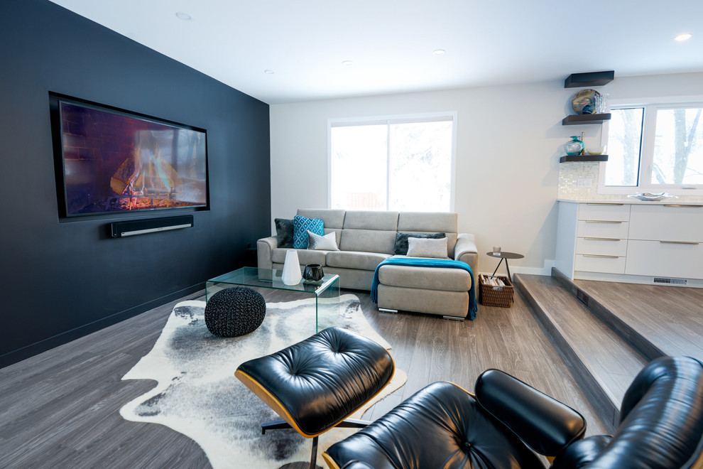 Small 1960s formal and open concept light wood floor living room photo in Other with black walls, no fireplace and a wall-mounted tv
