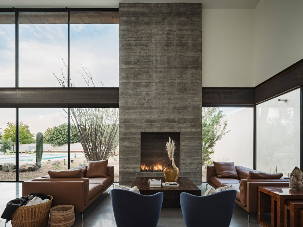 Minimalist concrete floor living room photo in Phoenix with a standard fireplace and a wall-mounted tv