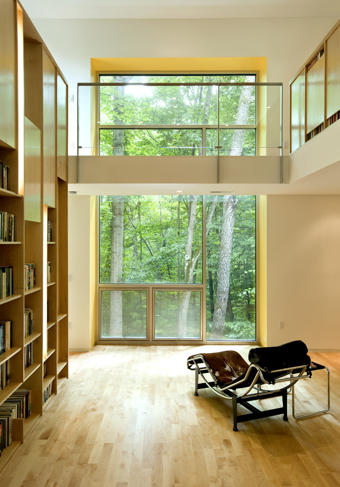 Inspiration for a contemporary living room library remodel in DC Metro with white walls
