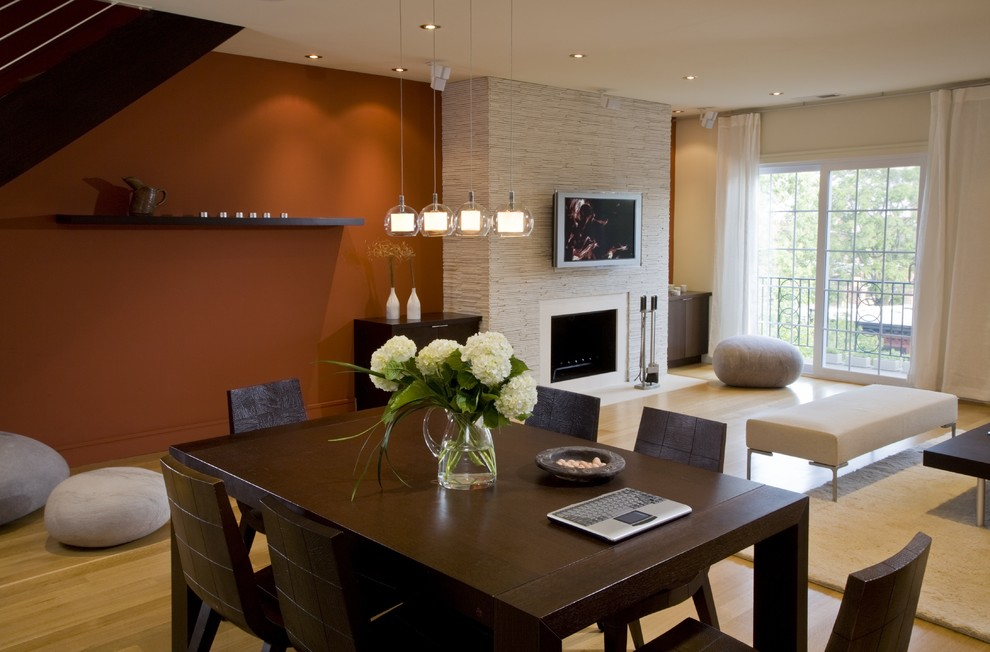 Minimalist living room photo in DC Metro with a standard fireplace and a wall-mounted tv