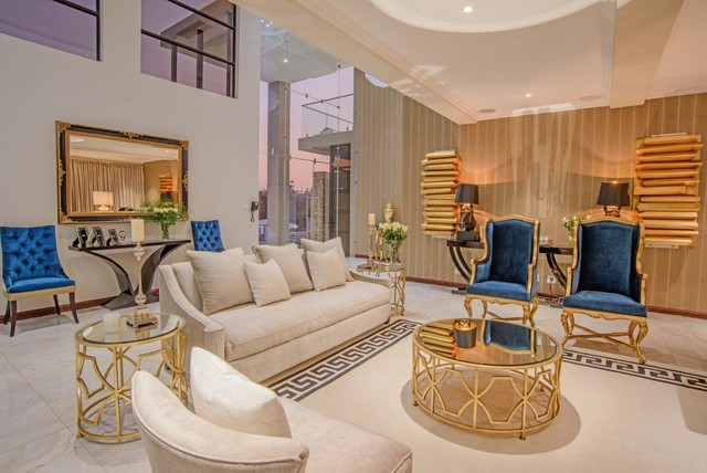 Formal living room ,entrance hall,gold leaf artworks and marble ...