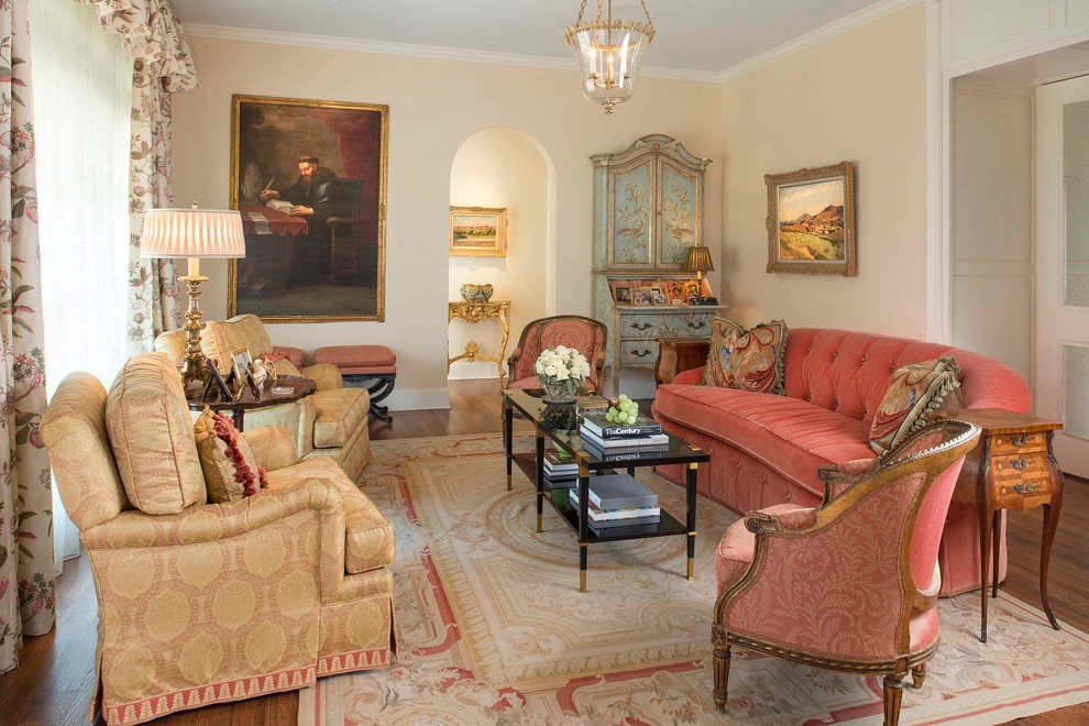 Inspiration for a victorian formal and enclosed medium tone wood floor living room remodel in Dallas with beige walls, no fireplace and no tv