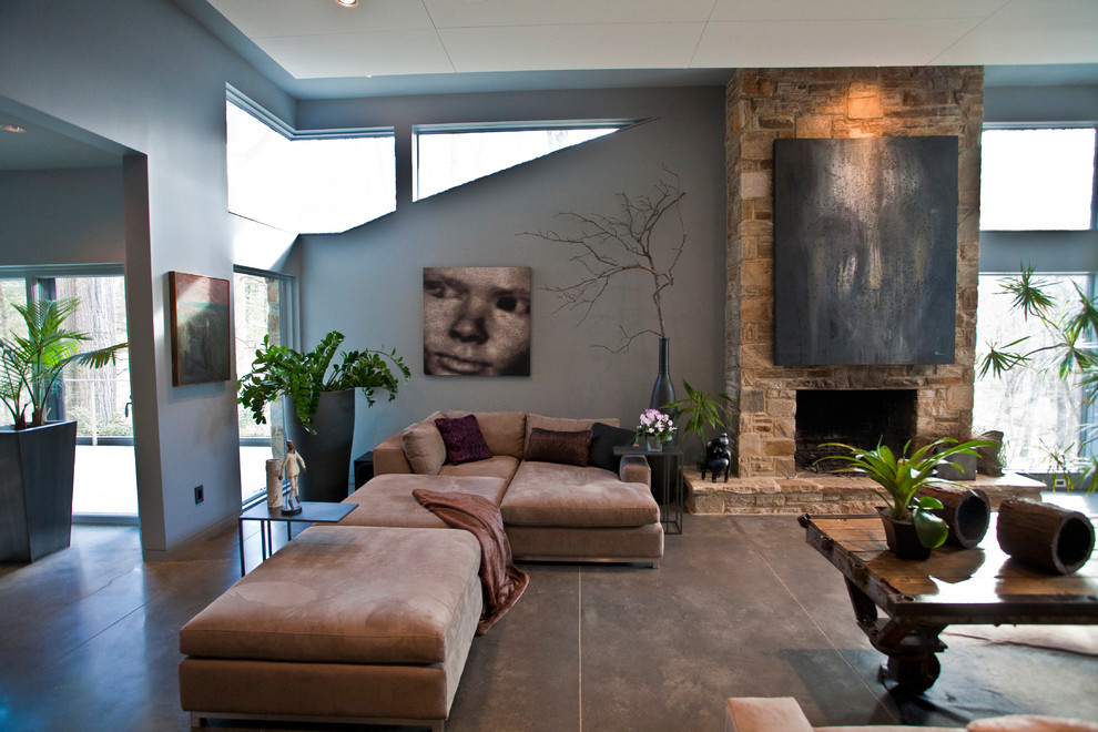 Large trendy open concept concrete floor and gray floor living room photo in Baltimore with gray walls, a standard fireplace, a stone fireplace and no tv