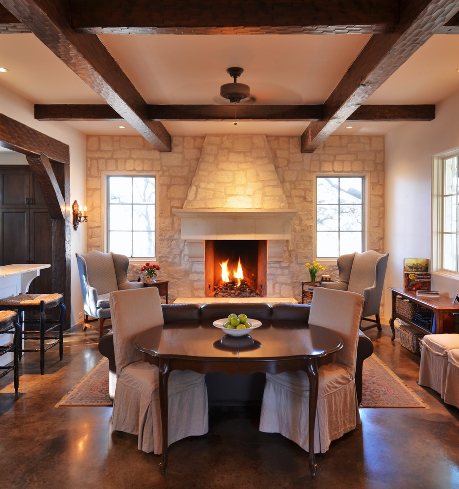 Farmhouse open concept concrete floor living room photo in Austin with a stone fireplace