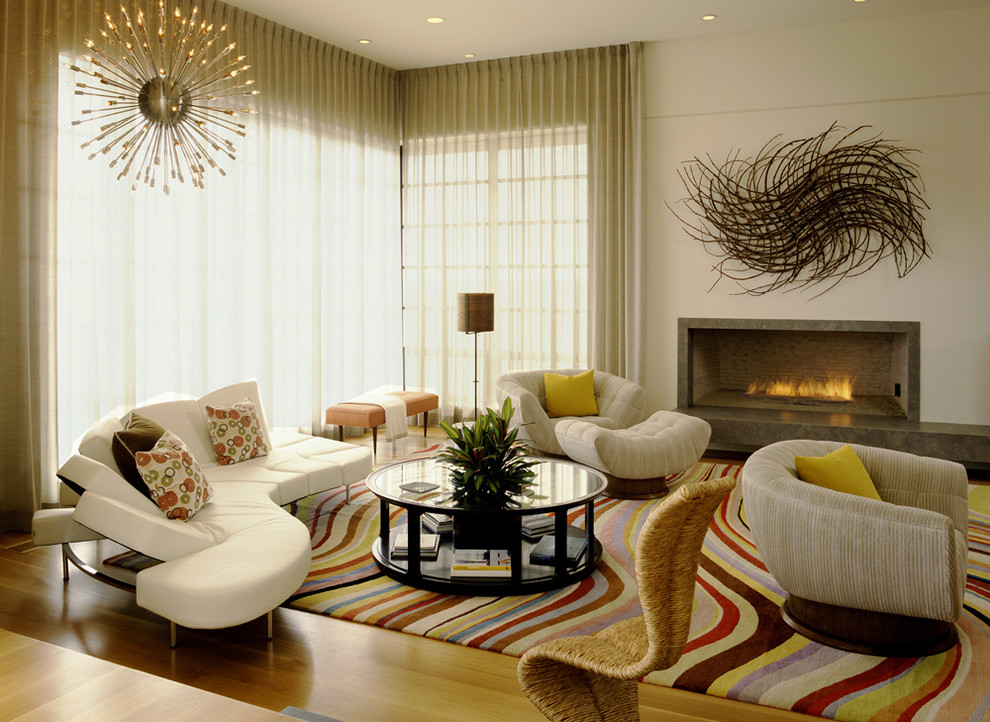 Large trendy living room photo in Orange County with beige walls and a ribbon fireplace