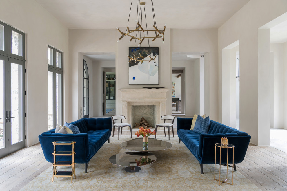 Inspiration for a large country formal and open concept light wood floor and beige floor living room remodel in Houston with a stone fireplace, no tv, white walls and a standard fireplace