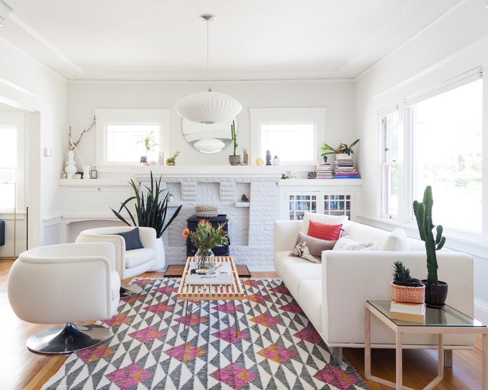 Living room - mid-sized transitional open concept medium tone wood floor and white floor living room idea in San Francisco with white walls, a standard fireplace and a brick fireplace