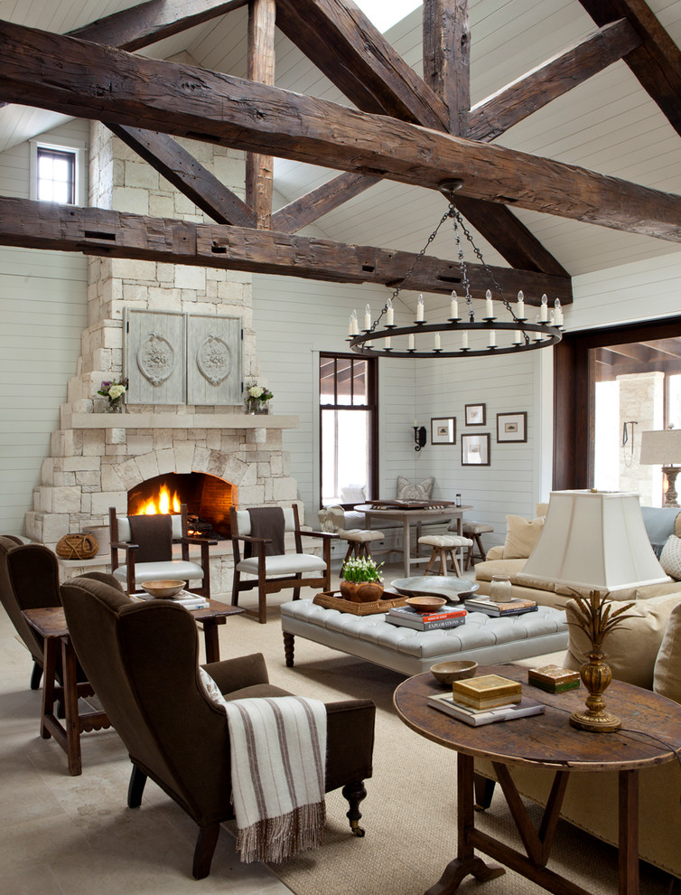 Example of a cottage open concept living room design in Austin with white walls, a standard fireplace, a stone fireplace and no tv
