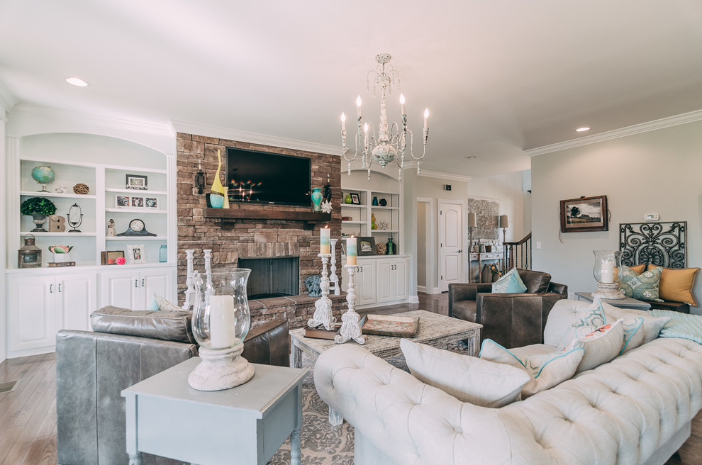 Inspiration for a large shabby-chic style enclosed and formal dark wood floor and brown floor living room remodel in Nashville with gray walls, a wall-mounted tv, a standard fireplace and a stone fireplace