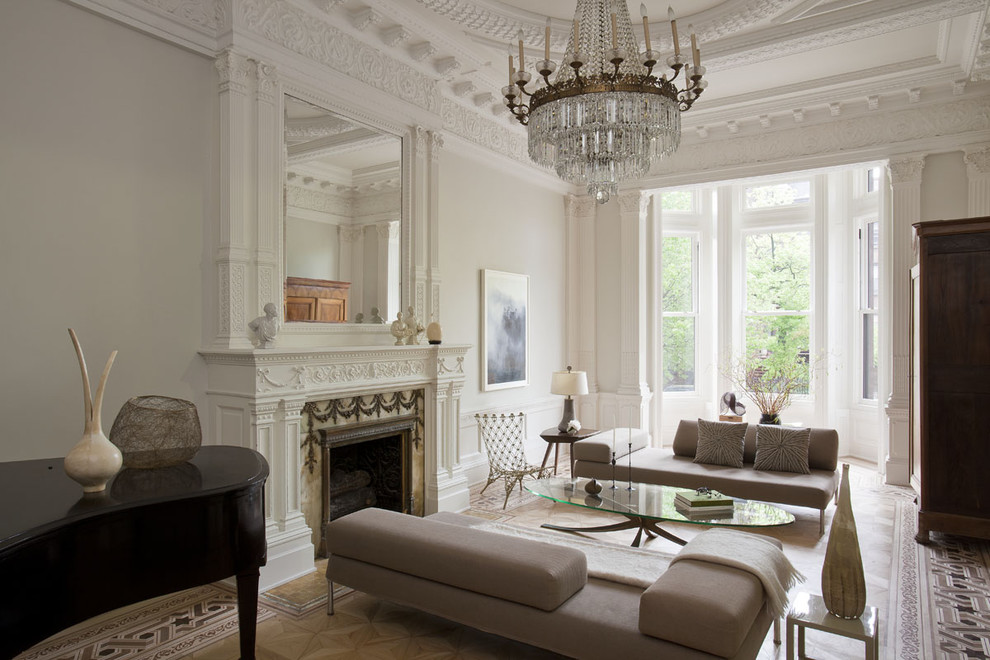 Elegant formal medium tone wood floor living room photo in New York with white walls, a standard fireplace and no tv