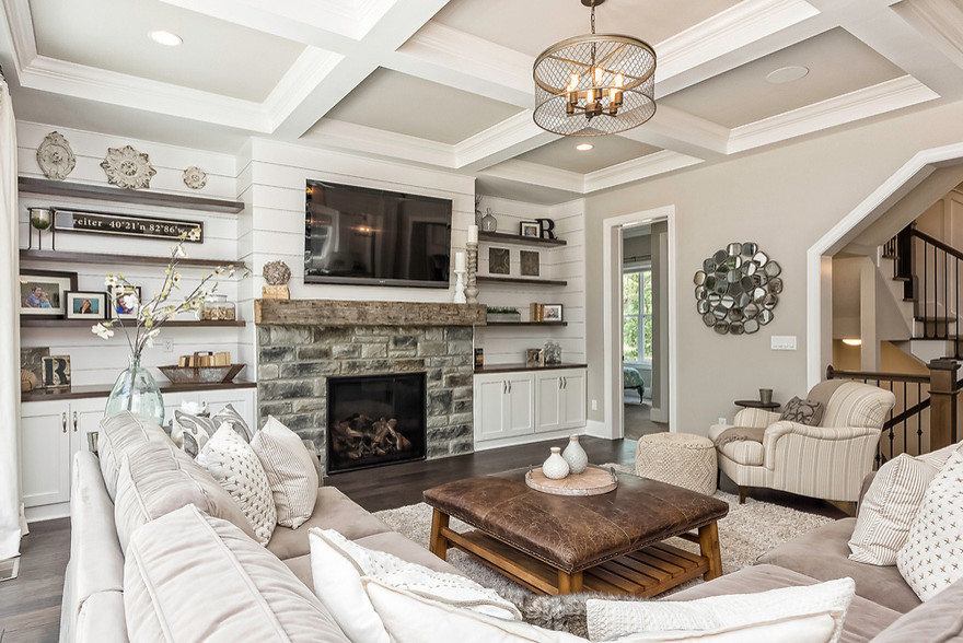 Living room - mid-sized farmhouse enclosed dark wood floor and brown floor living room idea in Columbus with beige walls, a standard fireplace, a stone fireplace and a wall-mounted tv