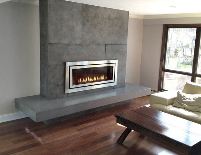Concrete fireplace surround fabricated and installed by Trueform Concrete. The hearth was floating on an extended wooden sub frame and spanned over 10