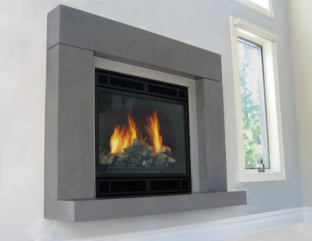 This is a concrete fireplace surround by Trueform Concrete. This project features the Beam Fireplace with a  floating hearth cast in a light grey concrete.
