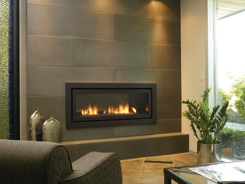 Installation of these tiles over existing fireplace and wall. - Similiar Contemporary Fireplace Tile Keywords