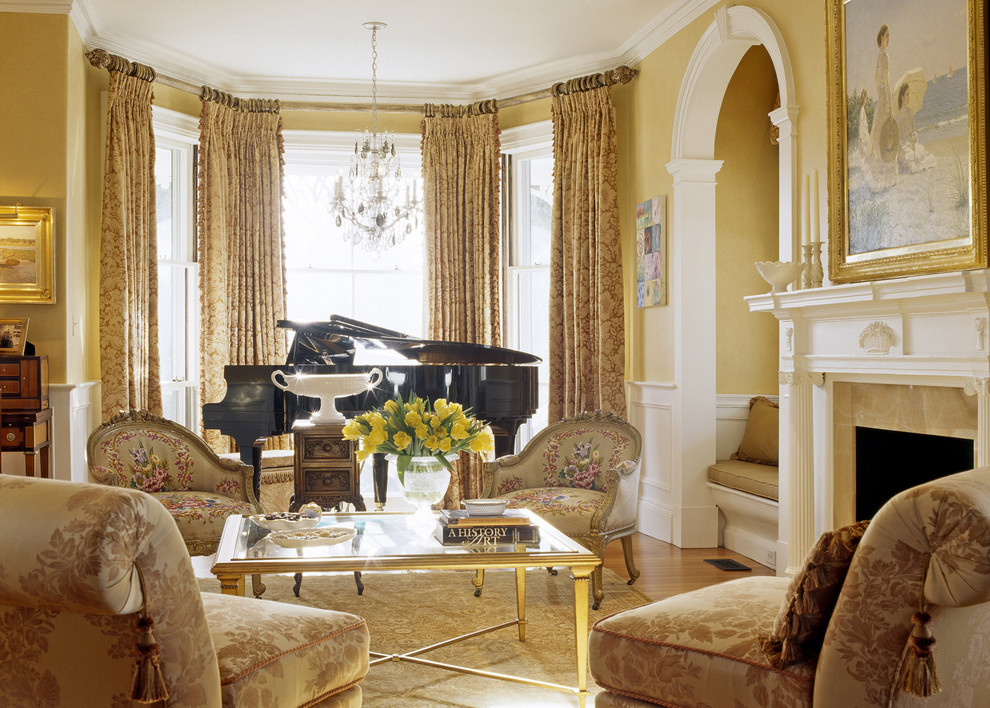 Example of an ornate living room design in Boston with a music area and yellow walls