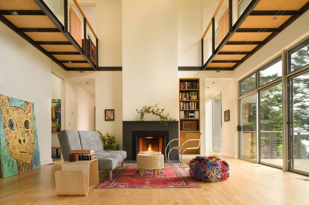 Inspiration for a modern living room remodel in Seattle with white walls