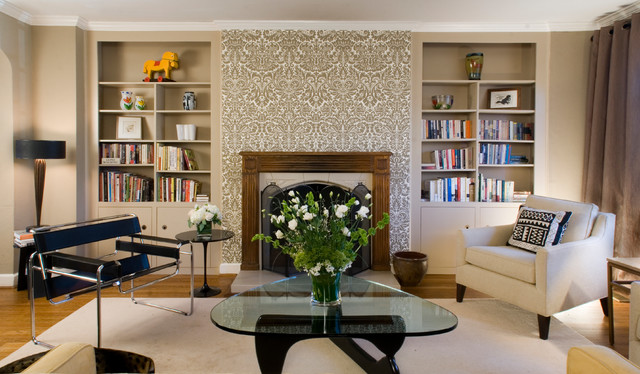 Example of a transitional living room library design in DC Metro with beige walls and a standard fireplace
