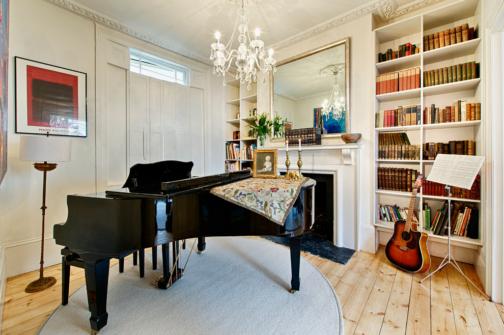 Inspiration for a mid-sized timeless open concept living room remodel in London with a music area, white walls, a standard fireplace and no tv