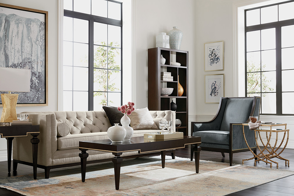 Example of a mid-sized trendy formal and enclosed dark wood floor and brown floor living room design in Sacramento with white walls, no fireplace and no tv