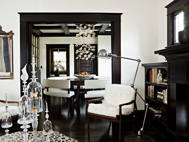 Elegant Black Floor Living Room Photo In Portland With White Walls