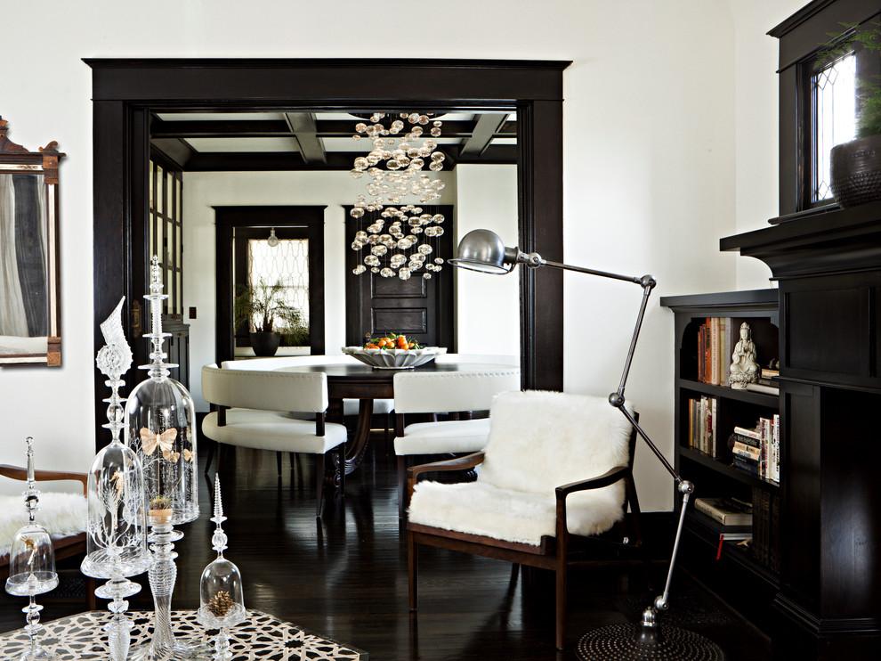 Elegant black floor living room photo in Portland with white walls